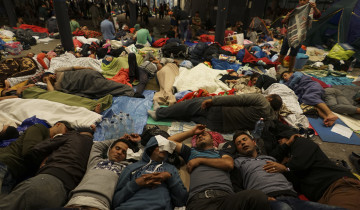 Mstyslav Chernov/Unframe - Syrian refugees having rest at the floor of Keleti railway station. Refugee crisis. Budapest, Hungary, Central Europe, 5 September 2015.